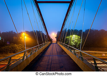 Bridge over freeway in the early morning with fog