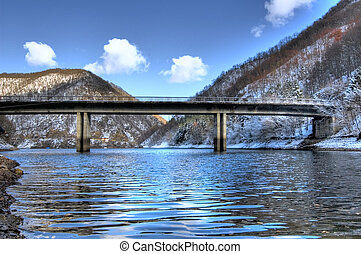 bridge over frozen lake