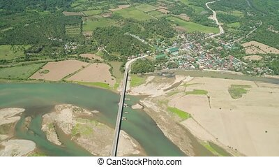 Bridge over river. - Aerial view of bridge over river with...