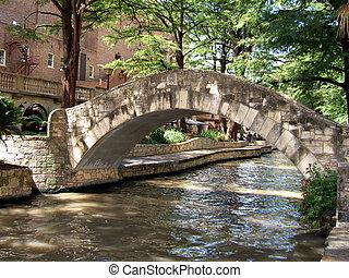 Old stone bridge over river in San Antonio