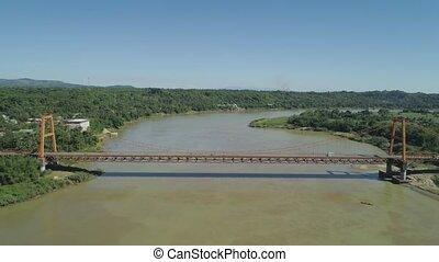 Bridge over river. Philippines, Luzon - Aerial view of...