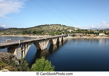 Bridge over the Burguillo Reservoir in Iruelas Valley Natural Reserve, Avila, province Castilla y Leon, Spain