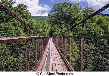 bridge over the mountain river