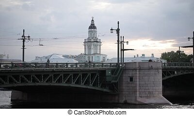 Bridge over the river in St. Petersburg and white temple in...