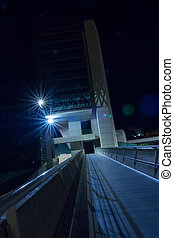 Bridge pedestrian walkway of Moneo, modern structure at night in