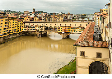 Bridge Ponte Vecchio in Florence on a cloudy day in autumn