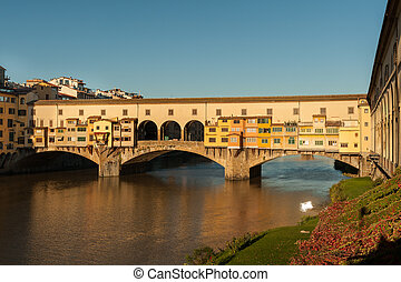Bridge Ponte Vecchio in Florence on a sunny day in autumn