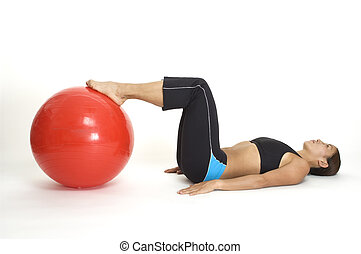 Bridge Pose 3 - A female fitness instructor demonstrates the...