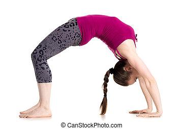 Bridge pose - Sporty beautiful young woman doing Bridge...