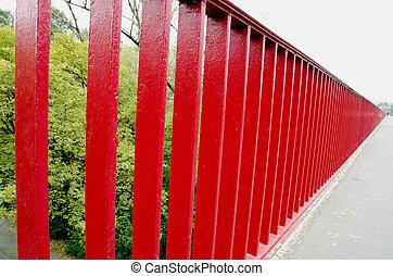 Bridge railing painted red background closeup