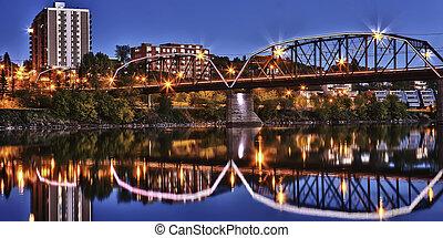Bridge relecting in calm River - The Victoria Bridge in ...