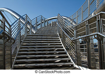 Bridge steps. - A set of stainless steel steps leads to a...