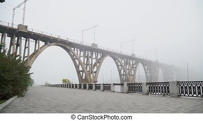 Bridge stretching into the fog