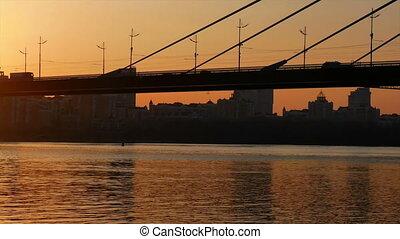 Bridge sunset view river - Silhouette of bridge golden...