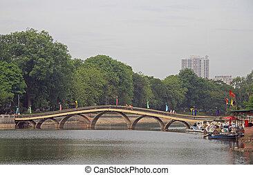 bridge through lake in the downtown of Hanoi