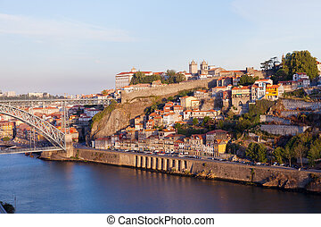Bridge through River Douro in the city of Porto, Portugal at sunrise