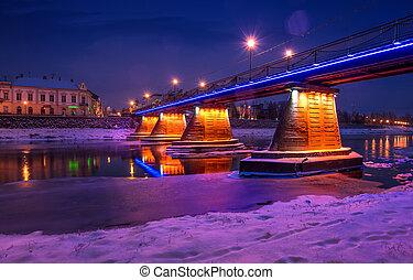 bridge through the river Uzh at night. beautiful cityscape...