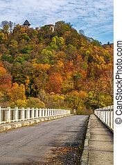 bridge to Nevytsky Castle hill in autumn - Nevytsky Castle,...