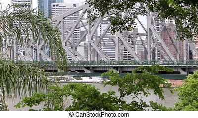 Medium wide shot of traffic crossing the Story Bridge in Brisbane Australia.