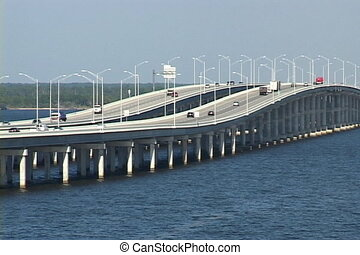 Bridge Traffic - Trucks and automobiles travel across the...