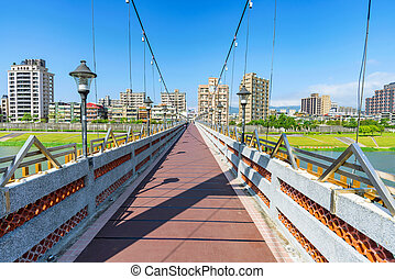 Bridge with cityscape on a sunny day