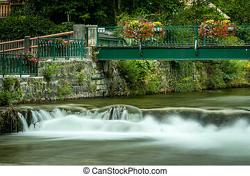 Bridge with colorful flowers in Bad Aussee
