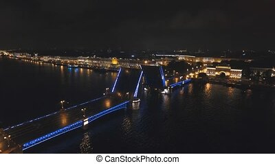 Bridge with illumination over the river at night - Aerial...