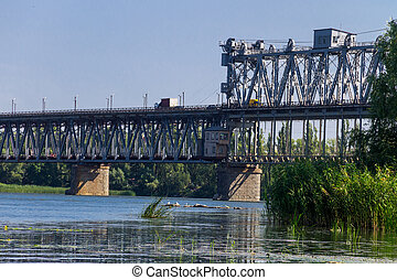 Bridge with traffic over the Dnieper river in Kremenchug, Ukraine