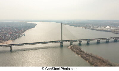 Bridge with trafic over the river aerial drone footage. -...