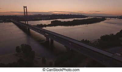 Bridge with trafic over the river at sunset aerial drone...