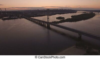Bridge with trafic over the river at sunset aerial drone footage