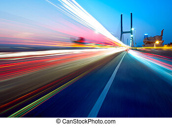 Bridges and light trails - cars light trails on the modern...