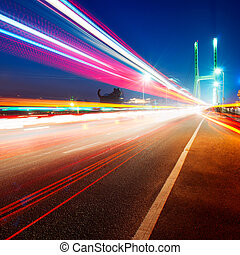 Bridges and light trails - cars light trails on the modern...