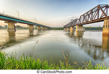 The Diefenbaker Bridge and old train bridge over the North Saskatchewan River in Prince Albert, Saskatchewan.