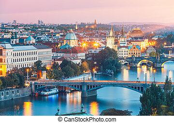 bridges with historic Charles Bridge and Vltava river at night in Prague, Czech Republic
