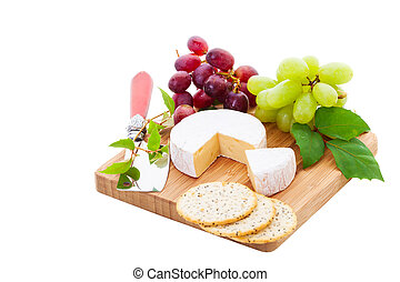 Brie and Crackers - Brie Cheese and crackers with grapes on...