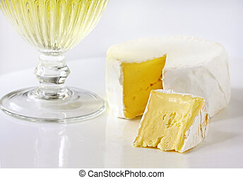 Brie and Wine - Soft brie cheese, with a glass of white...