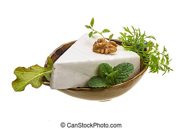 Brie cheese with herbs isolated