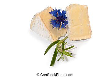 Two slice of a nice brie, and rosemary and a blue fieldflower