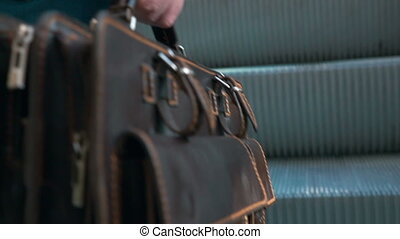 Brief Case in Male Hand - Slow motion closeup shot of a...