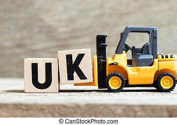 brief, woord, (abbreviation, k, kingdom), uk, verenigd, hout speelgoed, blok, houden, achtergrond, vorkheftruck, compleet
