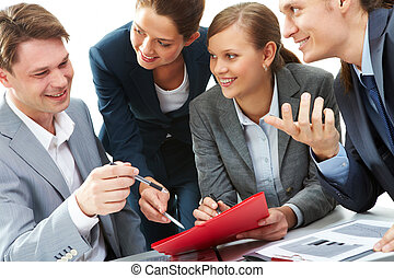 Briefing - Photo of business partners showing document to...