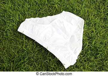 Briefs - Pants in the grass as a backdrop.