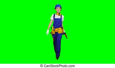 Brigadier girl comes with a drill in her hands. Green screen