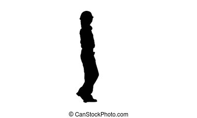 Brigadier girl comes with a drill in her hands. Silhouette. White background. Side view