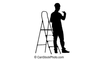 Brigadier in a helmet stands near the stepladder. Silhouette. White background. Slow motion