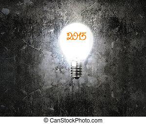bright 2015 light bulb illuminated dark old mottled concrete wal