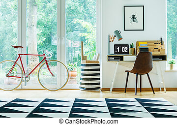 Bright apartment with red bicycle