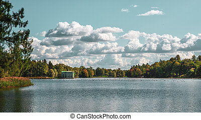 Bright autumn landscape with a lake in the Park. Gatchina. Russia