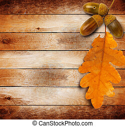 Bright autumn leaves on the old grunge wooden background